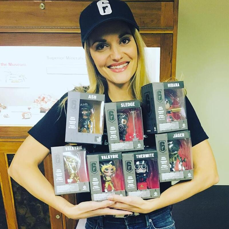 Patricia Summersett holding action figures during 2017 GeekU.P.